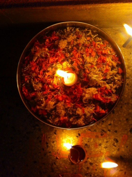 Flower Rangoli in a plate with candle in the centre