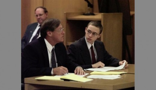 Defense attorney Richard Nichols (L) and now convicted murderer Joshua Phillips (R), sit at the defense table during jury selection July 6, 1999 in Phillips' trial for the murder of Maddie Clifton