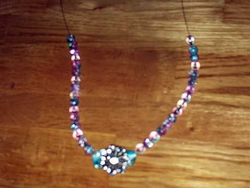 The necklace has reached the half way point.