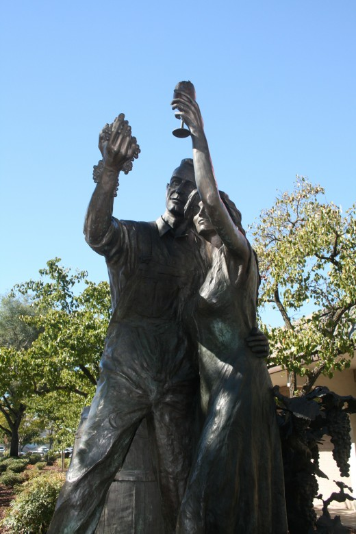 """""""Celebrate the Harvest"""" by sculptor Rowland Cheney is located on the corner of School and Oak streets in Downtown Lodi."""
