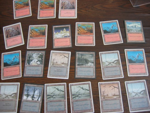 5. Make yourself some room on the table and lay the mana/land cards out face up in rows until they are all out.