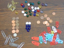"Glass beads, coins, paper clips all work great.  The game uses a lot of ""markers"" and ""counters"" and not just for tracking life points."