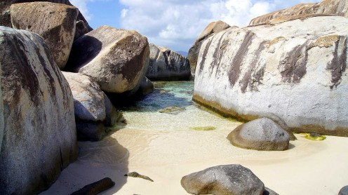 The baths at Virgin Gorda in the British Virgin Islands are famous because visitors can swim in between giant rocks.