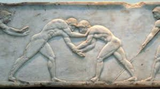 IMAGE: FUNERARY RELIEF (510–500 BC) DEPICTING WRESTLERS (FINGALO, LICENSED UNDER CC BY-SA 2.0 VIA WIKIMEDIA COMMONS)