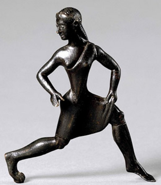 Bronze statuette of a girl wearing a short tunic. This type of figurine was manufactured in Sparta.[18] The single-shouldered garment, baring the right breast, was the characteristic dress of competitors in the Heraean Games