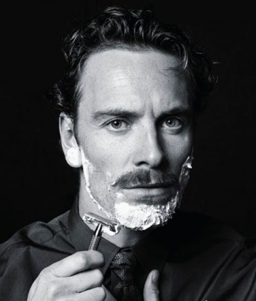 Michael Fassbender using a safety razor