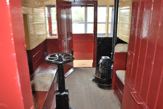 A look inside the brake van shows the period brake wheel left, and stove far right