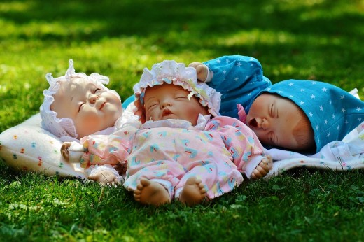 Three Dolls Teaching Humans to Smile