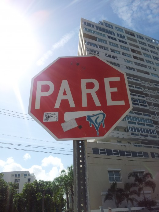 "Pare means ""Stop"" in Spanish."
