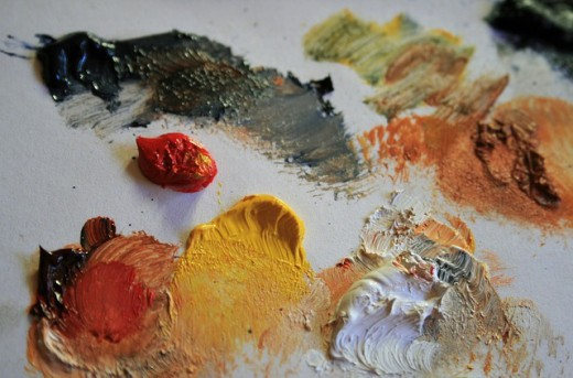 Paints on a palette in readiness for painting.