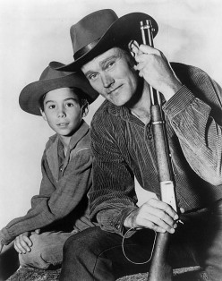 Johnny Crawford as Mark  McCain and Chuck Connors  as Lucas McCain his father  on The Rifleman