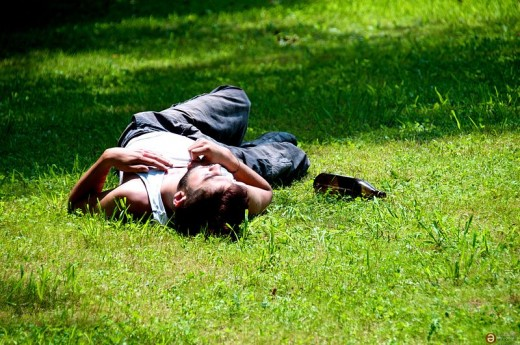 Drunk man passed out in park, but I bet that he had one great time