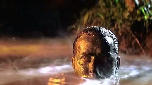 Willard emerging from the water before killing Kurtz
