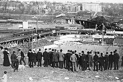 The Polo Grounds in its third incarnation, 1908.  The fans are viewing the game from Coogan's Bluff.