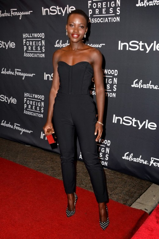 Lupita Nyong'o going retro with this jumpsuit. You'll be surprised what you can find in your aunt's or mother's old brown suitcase or a cardboard in the basement.