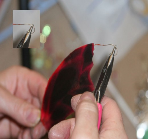 Form a hoop with the extra wire length using your needle nose pliers