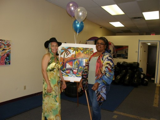 My friend, Moyaha, and I at my recent Art exhibit.  She is modeling one of my scarves from mY VIDA collection.