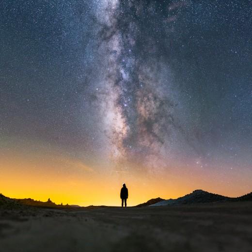 Milky Way lying above a lady's silhouette, at Trona Pinnacles National Landmark, California.