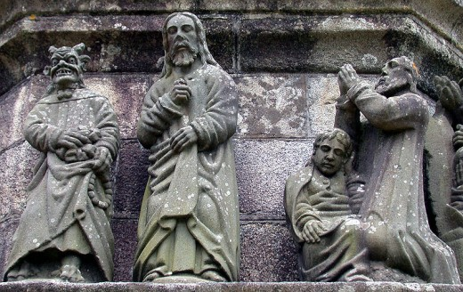 A depiction of Satan tempting Jesus and offering him bread, by Bastien Prigent. The Calvary at Plougonven, Brittany, France