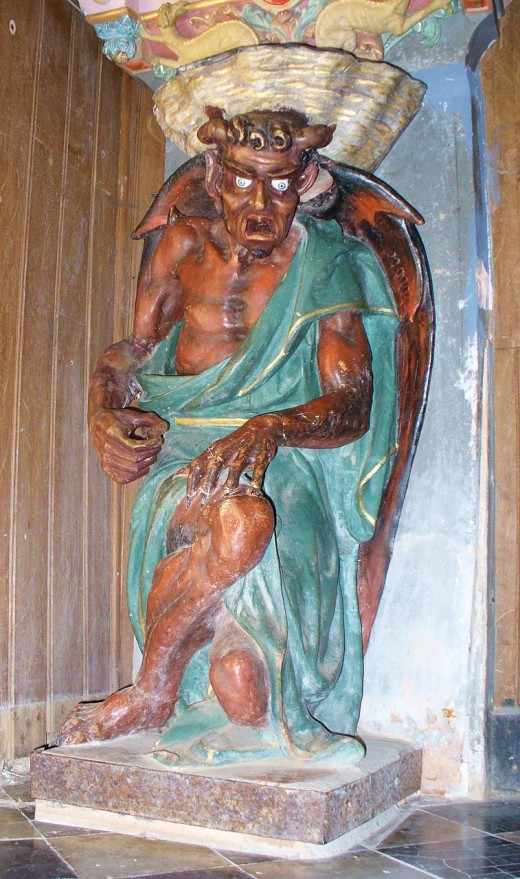 The figure of a Devil supporting the Holy Water Stoup. Rennes-le-Chateau, France