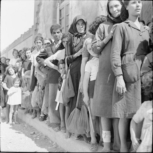 Civilians on the island of Rhodes queue to get their ration books from the British military authorities. During the German occupation the local inhabitants had suffered the effects of malnutrition due to insufficient food. After the liberation of the