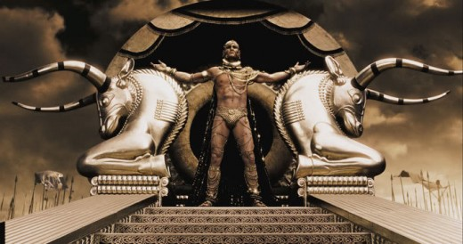 "King Xerxes from the movie '300' standing in all his finery looking down on the peasants saying ""I am a kind King"" a bit like celebs today expecting the watching public to worship them for being such good kind people fronting a charity show."