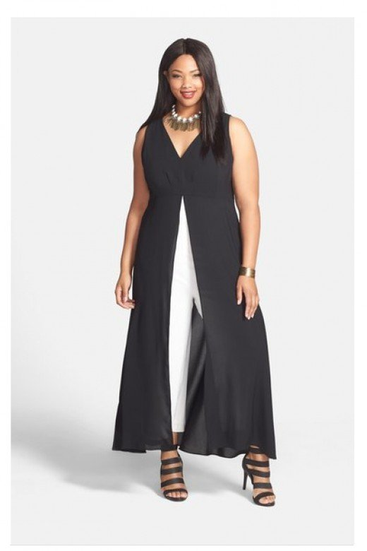 A cool and modern black and white jumpsuit.  Empire-waist cut features a contrasting inset for the ankle-sweeping skirt.