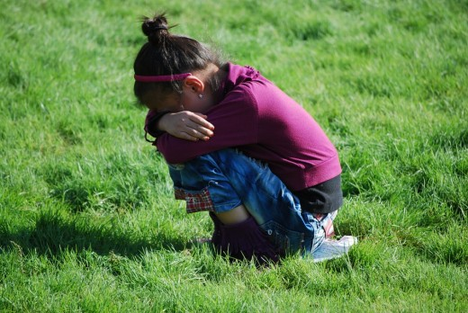 Sad girl crying all alone