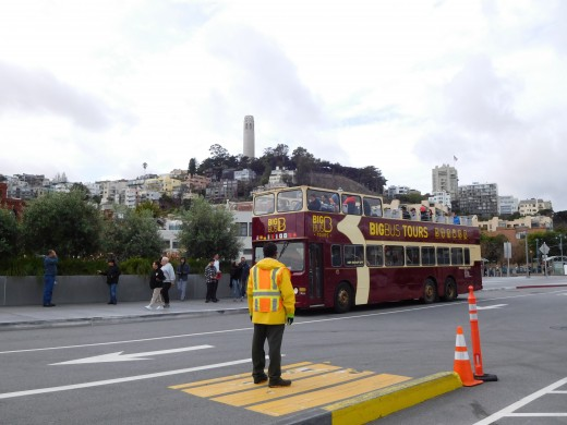 The Hop On Hop Off bus on which we toured San Francisco, with Coit Tower in the background.