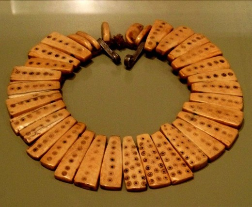 This necklace may have been part of the jewelry belonging to the Bwami religious and social organization. It is made of elephant ivory and the shape of each piece may refer to leopard's teeth. Ivory jewelry, like this, is worn as a symbol of status