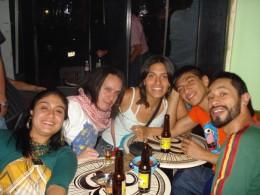 Friends enjoying mezcal.  Bloke second from left looks like he's swallowed the worm!