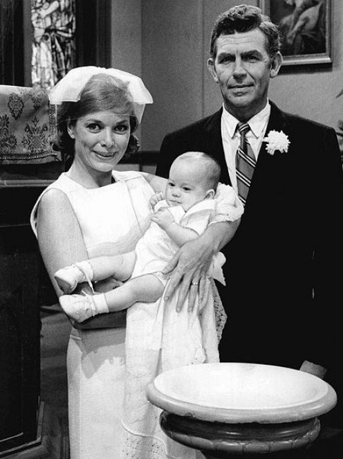 Aneta Corsault and  Andy Griffith from the  television program  Mayberry R.F.D.  Helen and Andy return  to Mayberry from Raleigh  for the christening of Andy Jr.
