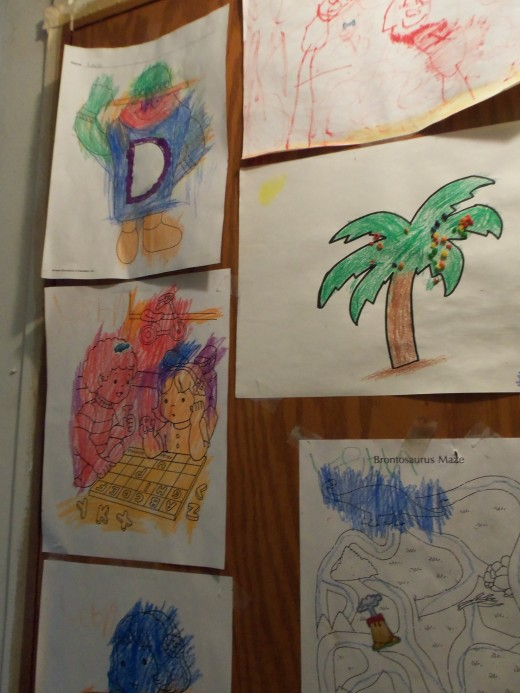 Granddaughter Leah's artwork hangs on the closet door in my entry way. It tickles her every time she sees it.