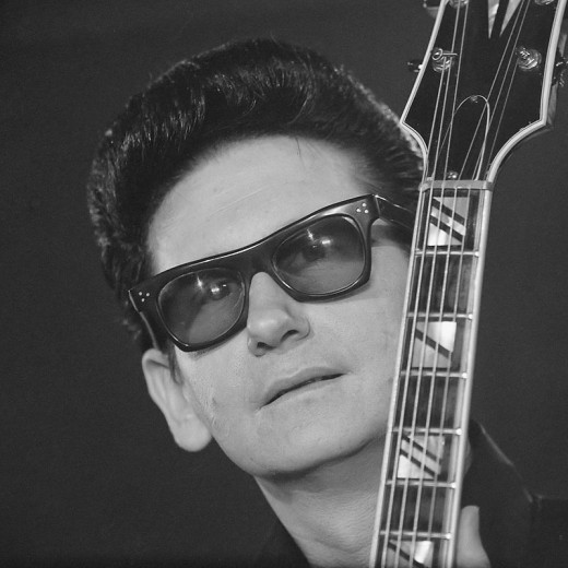 Orbison pictured in 1965 wearing his trademark sunglasses.  He began the look in 1963 when touring with The Beatles, after accidentally leaving his glasses on the plane.  Because of the sunglasses, there is a misconception that Orbison was blind.