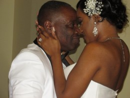 Darlena and Raymond, embrace during their wedding ceremony.