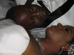 A photo of the couple as they laid on the floor for the photographers during the wedding reception.