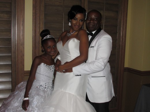 Raymond and Darlena, along with their daughter Alena, take a moment for a quick photo.
