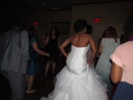 Darlena, dances in her beautiful gown with family and friends at her reception.