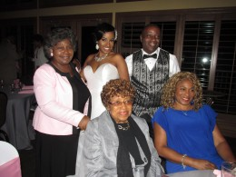 The bride and groom take pictures with different family and friends during the reception.