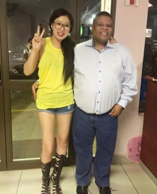 Minister David Mahlobo and manicurist Wei Chelsea