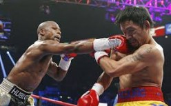 Money Mayweather beat Manny Pacquiao by unanimous decision in the largest grossing PPV in boxing history.