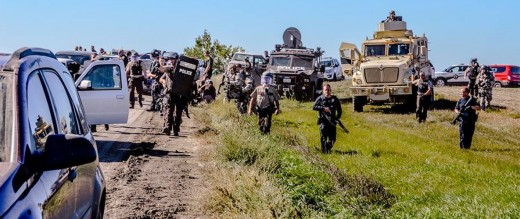 Police Advance on Native Americans Praying