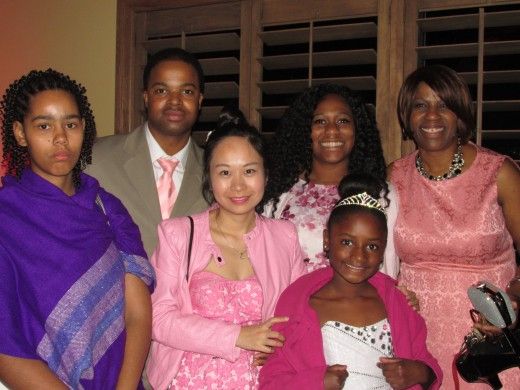 Dave, the brother of the bride, along with his wife Lily. The sister of the bride Serenity, along with her daughter Xylies. Patricia, mother of the bride and her daughter LaKia as well as other family members join in this photo.