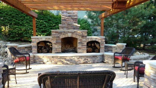 Stunning outdoor fireplace with storage voids covered with a stone veneer finish.
