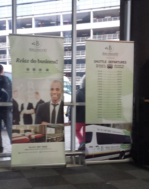 Signs for hotels like this Birchwood Hotel were posted within the bus terminal. Along with its pick up times,