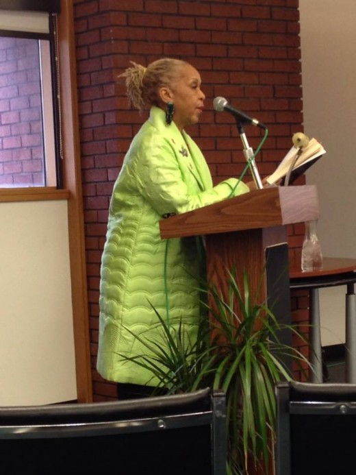 Performing a reading of her written work on World AIDS Day 2013 at Auburn Ave. Research Library., Atlanta, GA.