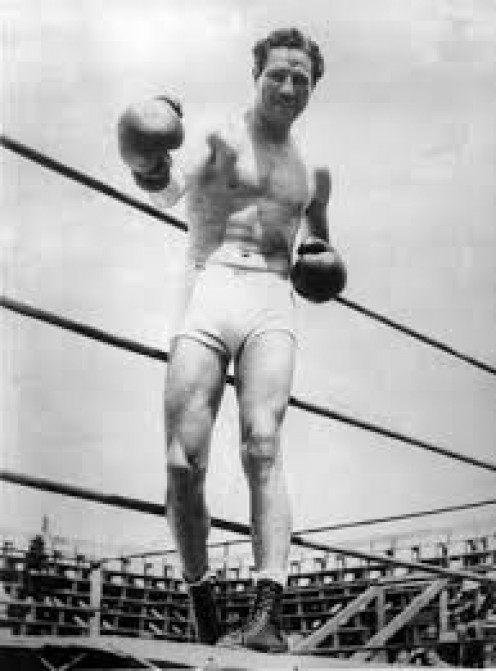 Max Baer, who held the heavyweight title during the 1930s, retired with a record that reads 66-13 with 51 knockouts. As you can se, Max Baer could really crack with his fists.