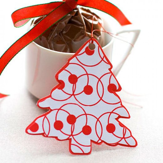 BHG.com has this pretty Christmas tree shaped free printable tag for your gifts.