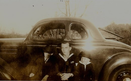 Young Byron next to his big brother in the Navy. Young brother Charles on the right of the photo.