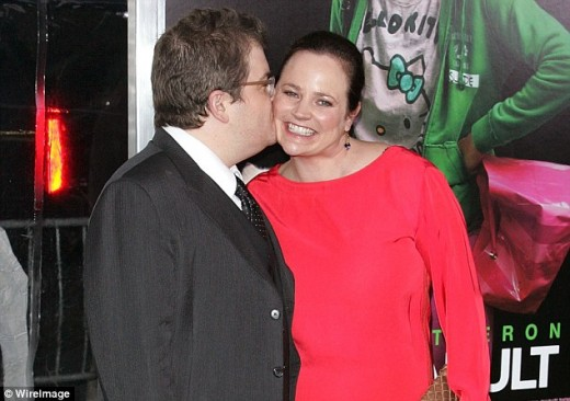 At an event, Patton Oswalt warmly kisses his wife, Michelle McNamara, who died in April 2016.  Oswalt has been very frank about moving on with their daughter, Alice, who is still quite young.